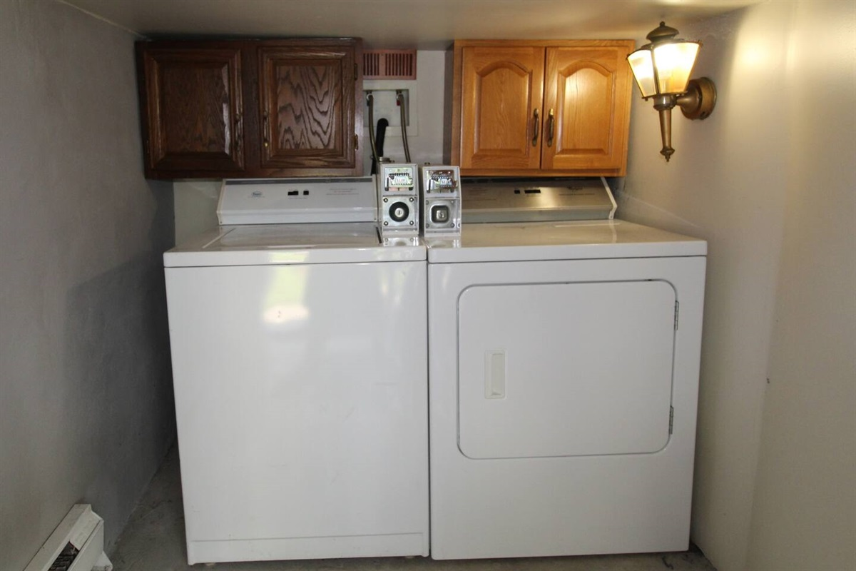 Shared laundry room for the building.  Laundry is FREE for our guests (Yes, they are coin op, but we provide the quarters!)