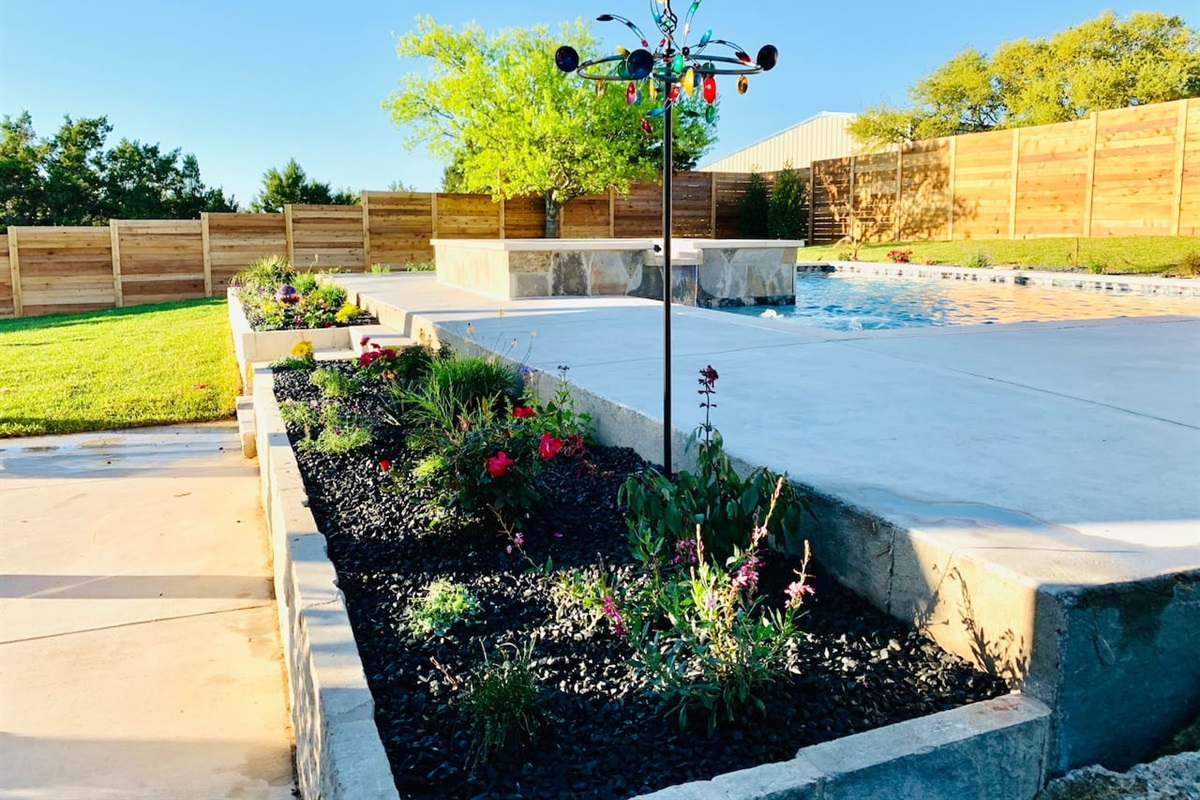 Newly landscaped yard, fencing and more. We're excited to share our happy home with you!
