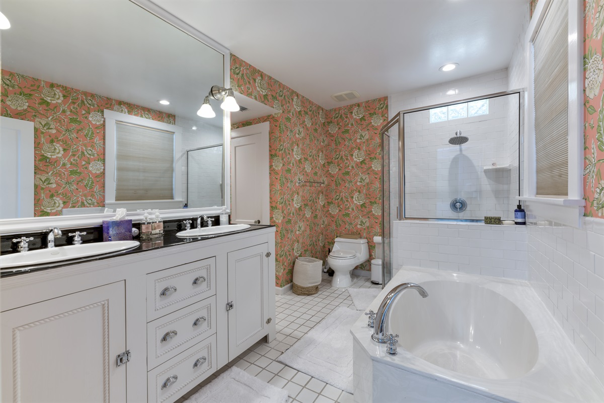 Master En-Suite bathroom with large deep tub and double sink vanity and walk in shower.