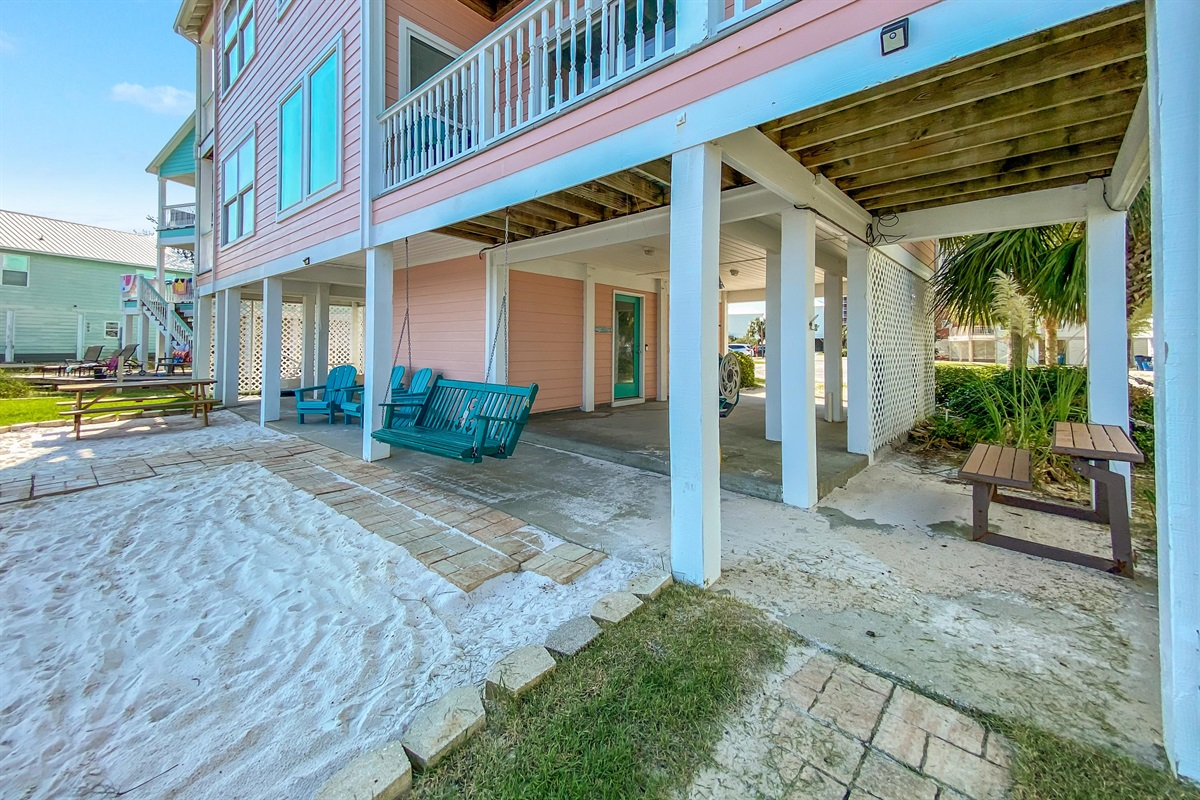 """Ground Floor Patio with Private """"Beach"""", Swing, Picnic Tables & Grills"""