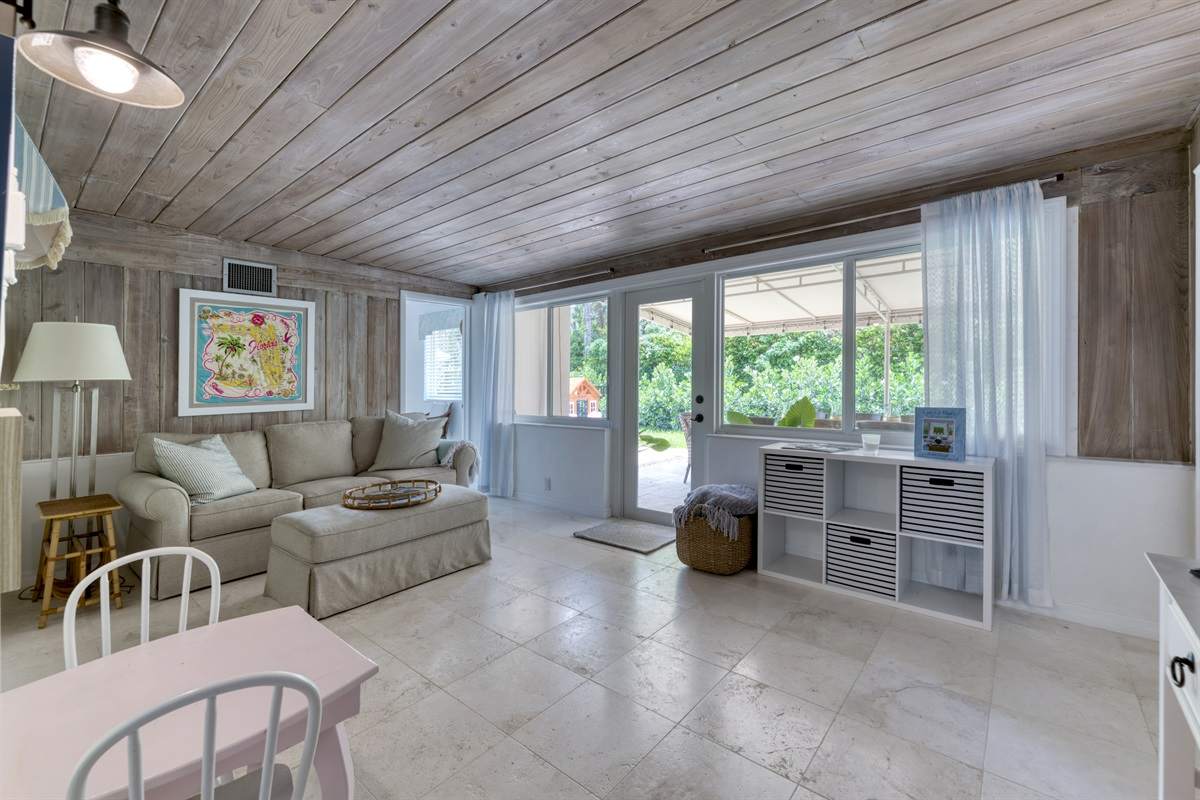 Natural light & warm Living Room area with Smart App TV which steps out onto the patio. The room has a 2nd bathroom with shower.