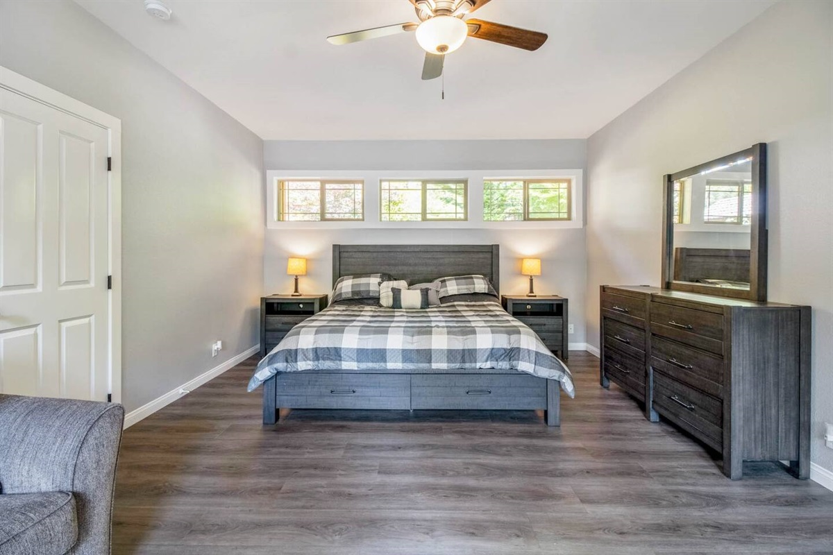 Master bedroom with king size bed and queen pullout sofa