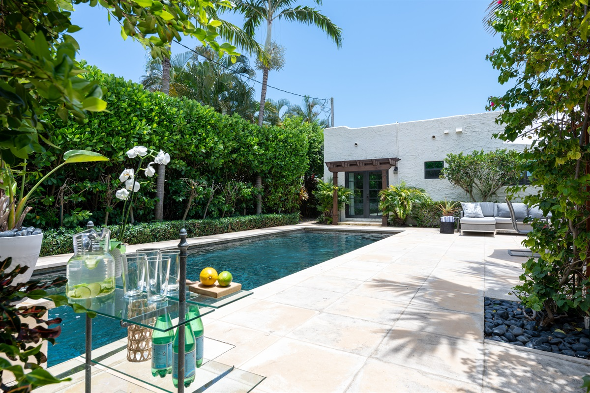 Welcome to the 1926 Pineapple House! Magnificent 3 BD/ 2 BTH with 1 BD/ 1BTH Pool House over looking a black rock heated pool with fountain!