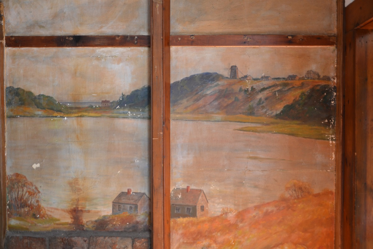 Original mural of Mill Pond from the shoreline of the Mill Pond Cottages with image of the famous Godfrey Windmill in Chase Park as seen in the distance. You can visit this historic landmark at Chase Park not far from downtown Chatham Village.