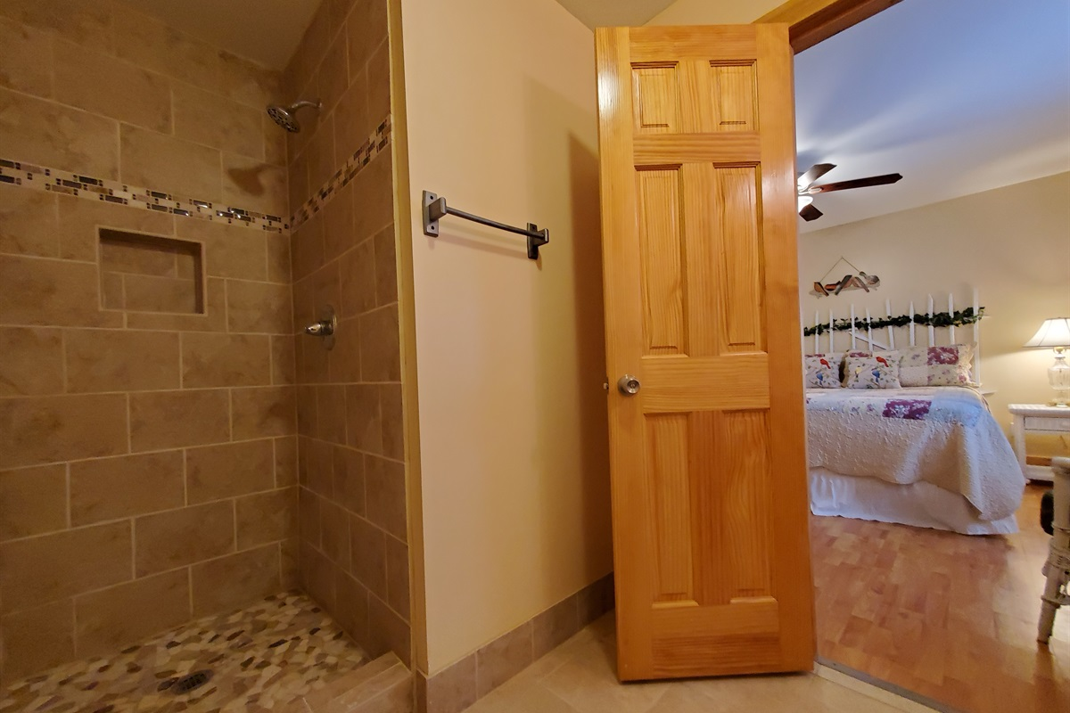 Newly remodeled full bathroom located off downstairs king bedroom