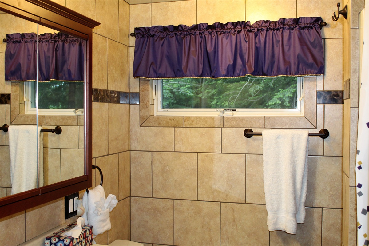 Upper level fully tiled bath with stall shower and heated bathroom floor