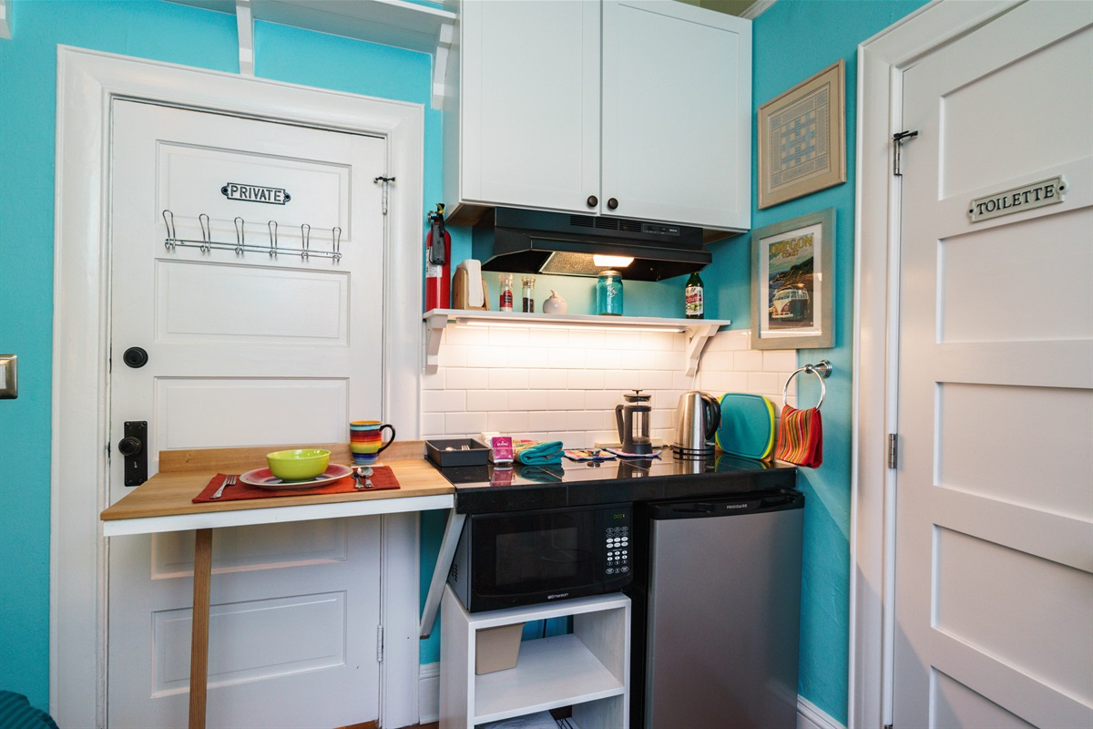 The Patio Suite kitchenette includes a microwave, toaster oven, mini-fridge, blender, coffee-maker, swing up counter extension, and folding counter stools.