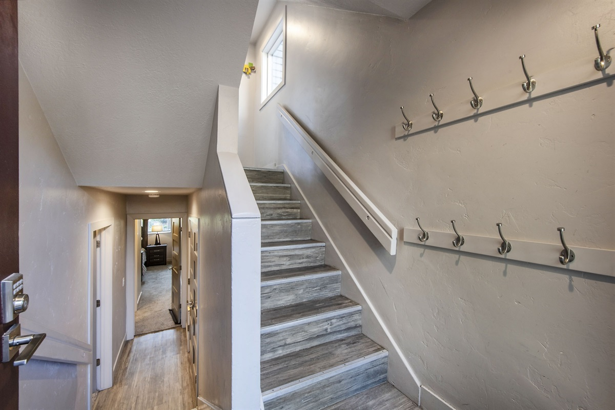 Entrance leading to main level and downstairs bedrooms