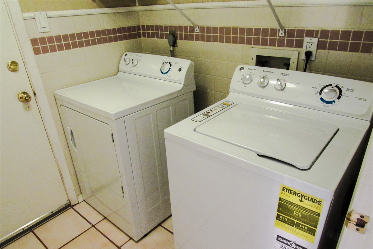 Laundry room w/ washer and dryer.