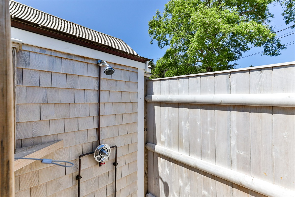 Stockade fencing surround the roomy outdoor shower for your privacy. There's nothing like seeing the blue sky and feeling the warmth of the sun and cool ocean breezes when enjoying a hot or cool outdoor shower after returning from the beach!