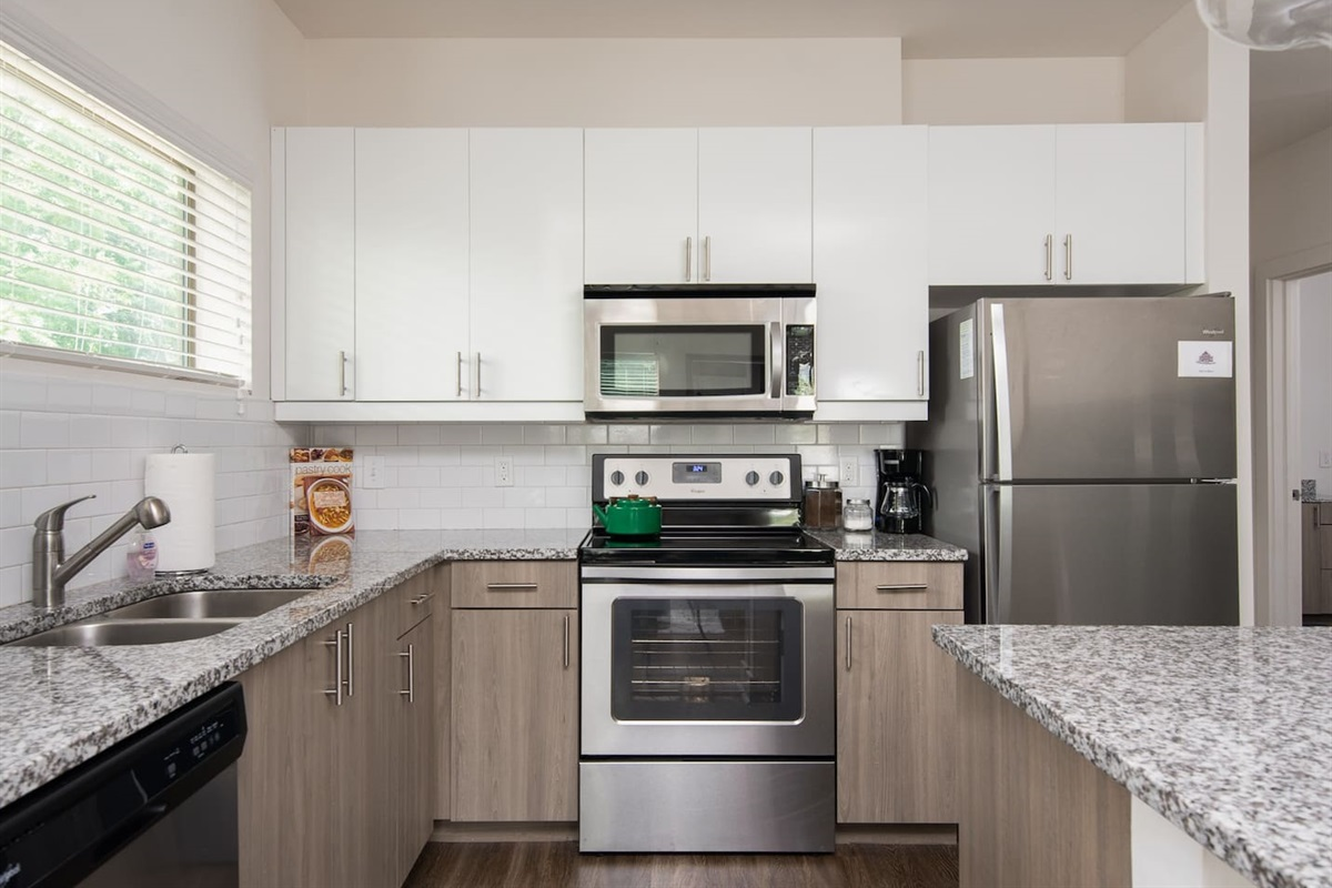 New kitchen with high ceilings, granite countertops and plenty of storage. All the amenities you could need if you choose to dine in! Free coffee/sugar/creamer!