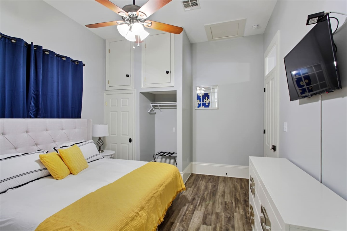 """Bedroom 5. 1 king bed. 39"""" tv. En-suite bathroom. Luggage rack."""