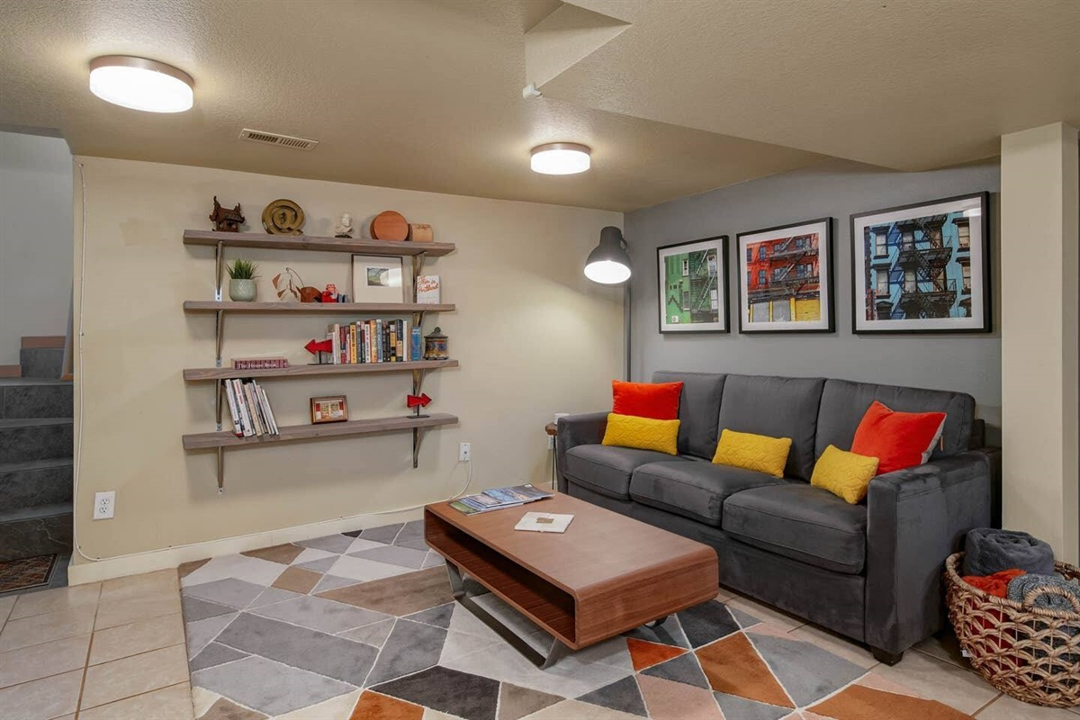 Gorgeously furnished urban oasis is yours. Enjoy your stylish and comfy living room, with a plush memory foam queen sleeper sofa. Art & decor recently updated with new ownership.