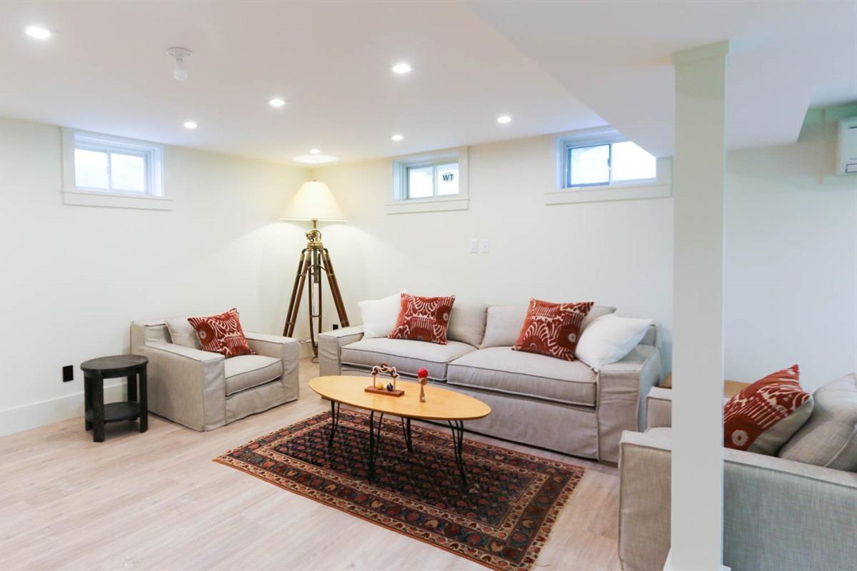 Garden Level Game Room with sofa sleeper by Restoration Hardware