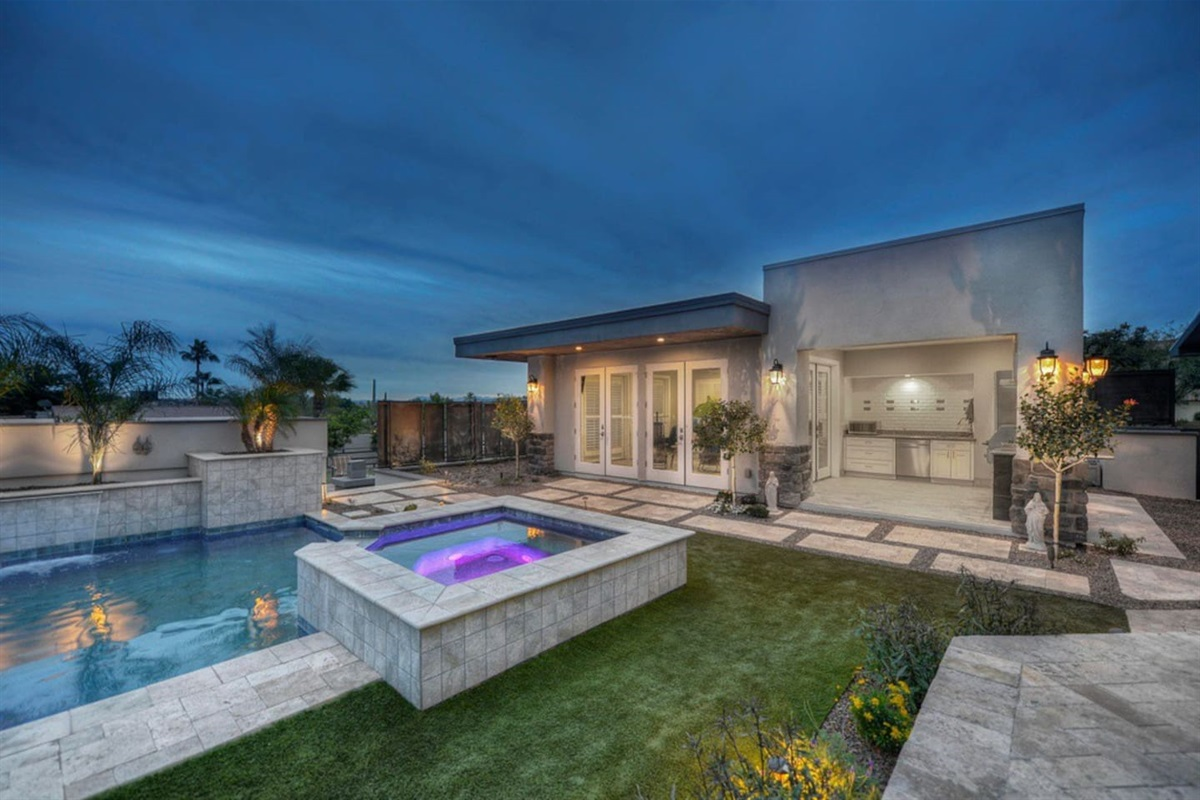 Relax in amazing jacuzzi next to the full outdoor kitchen and pool house!