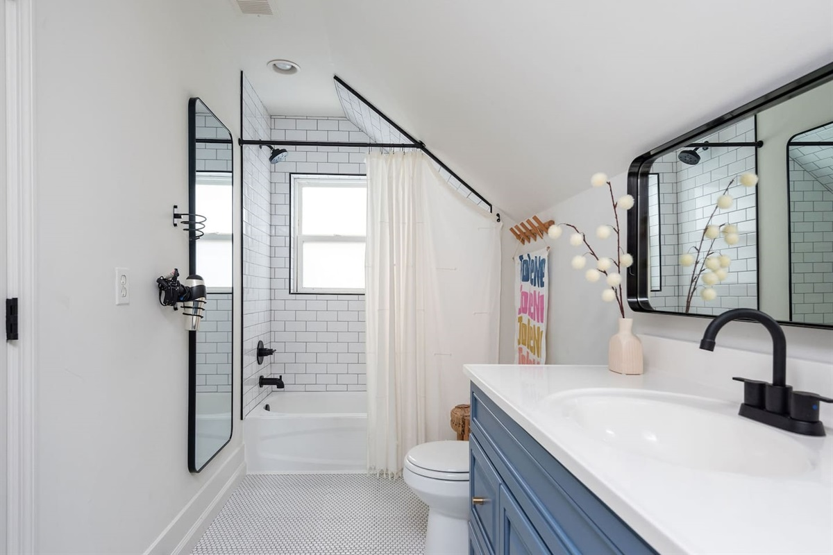 Located on the second floor this fully remodeled bathroom is stocked with shampoo, conditioner, bodywash, and fresh towels for your stay!