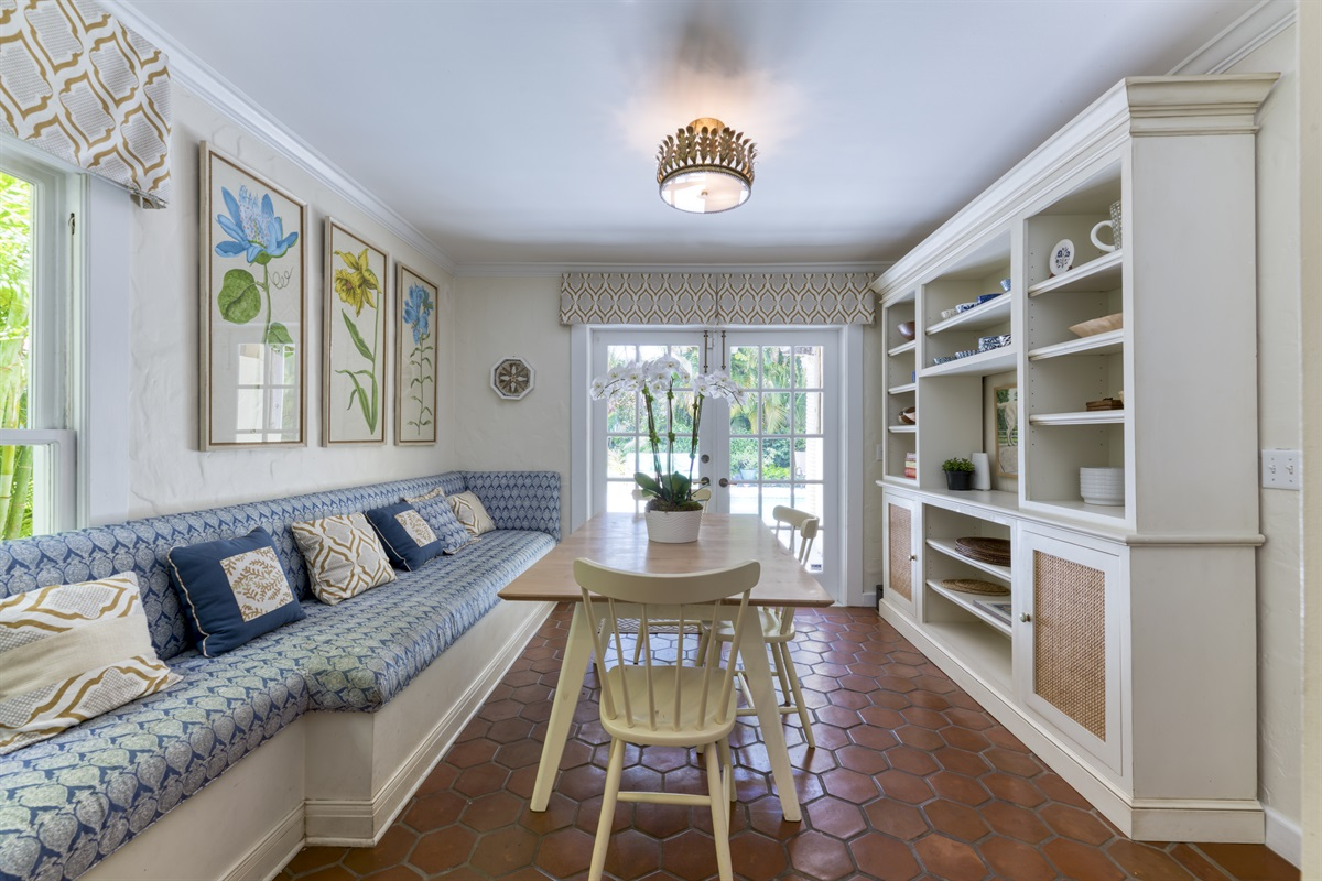 Feel at home in the breakfast nook with long bench seating and country- style table that is  connnected to the kitchen. Enjoy your morning eggs with direct views of the pool deck and access through the french doors.