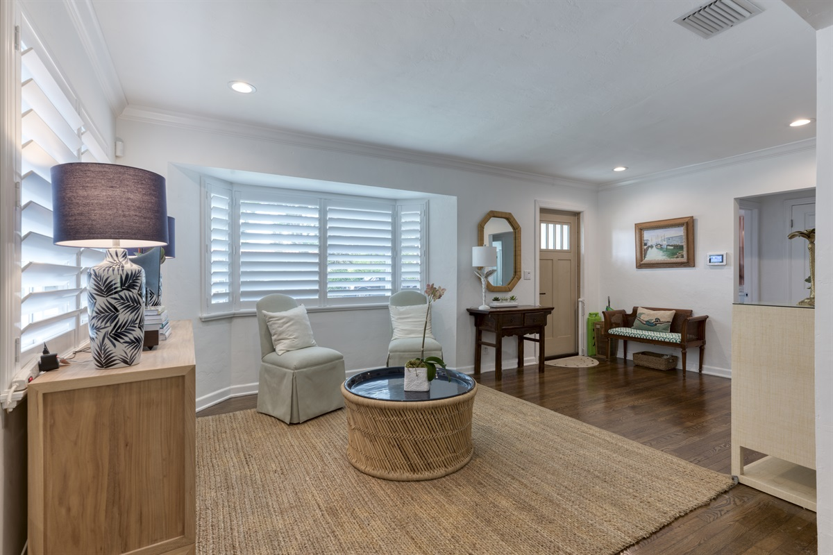 Walk through the entrance to the stunning homey, bright & happy family-friendly home in ElCid West Palm Beach. Lovely sitting area with cabinet full of games for family fun!
