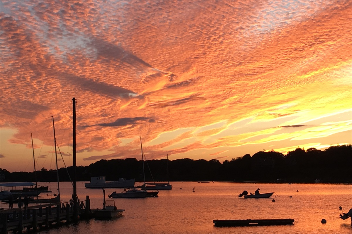 Incredible sunsets over Mill Pond visible from property and our private resident boat launch. _