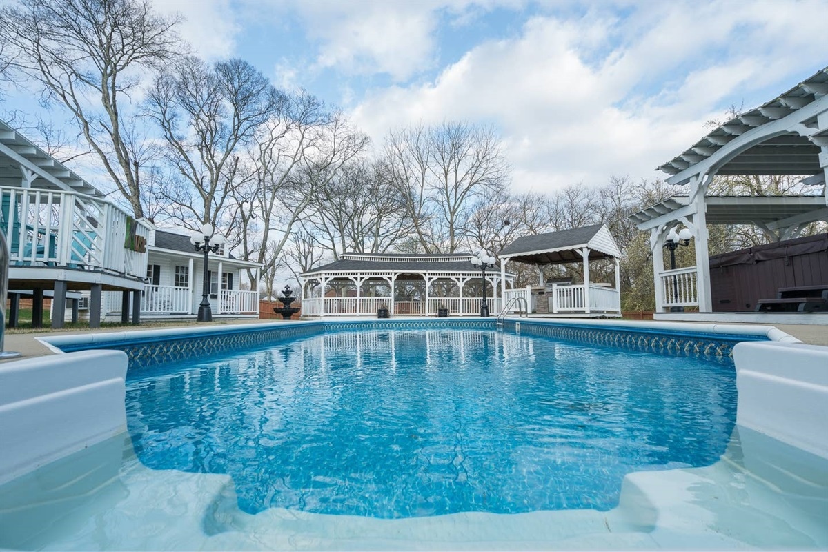 This is your backyard! :) private saltwater pool, hot tub, pool house with endless hot water shower, gas grill, outdoor fridge, fire pit, three covered decks!!