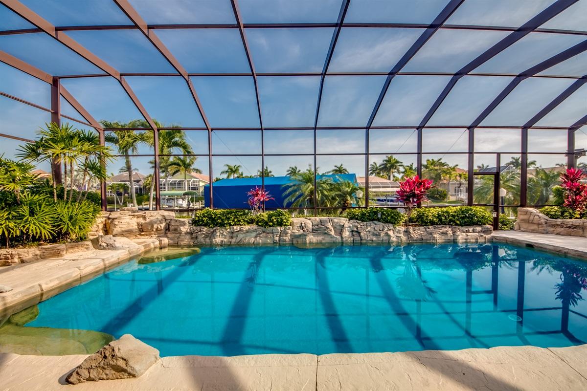Lush landscaping around pool