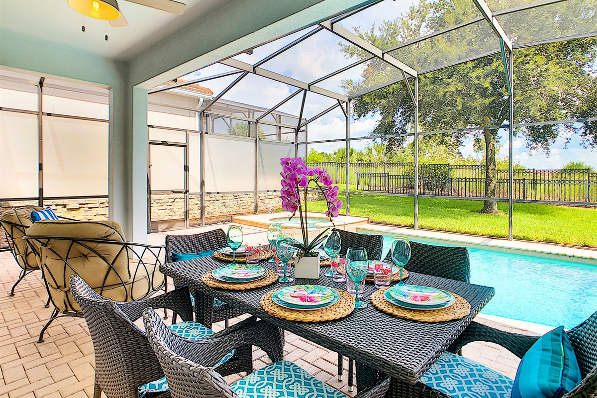 Covered Lanai - Dining Table And Television