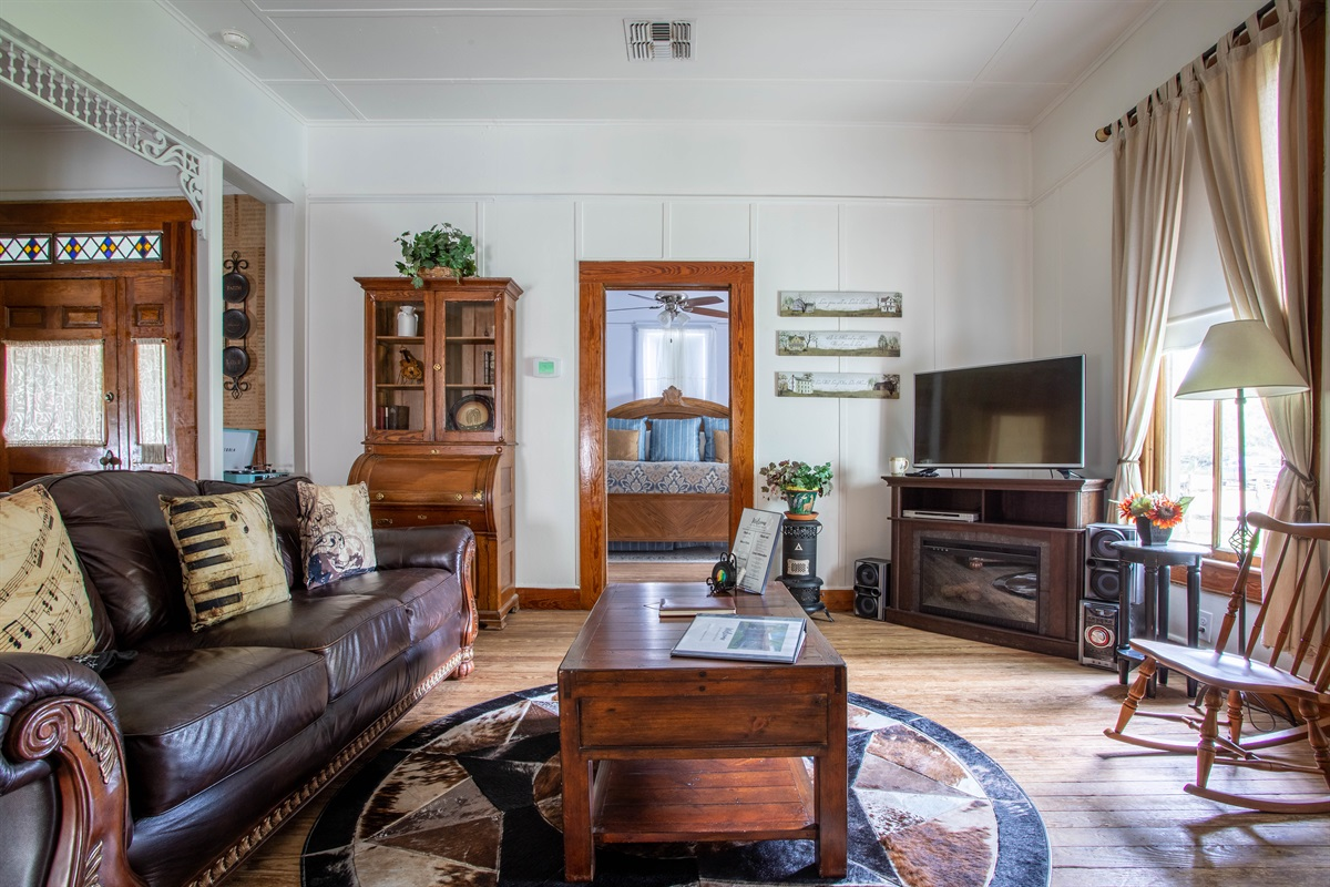 The living room maintains an old-world feel while still having modern touches: relax amongst the antique furniture and enjoy the Smart TV & bluetooth speaker