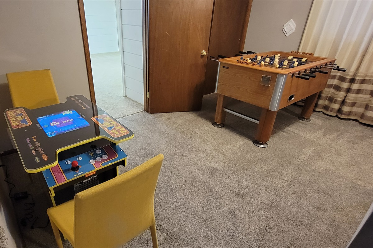 Super fun game room with arcade games, foosball, Will, and a big screen TV!
