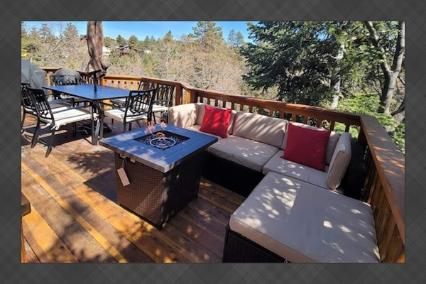 Private balcony with wrap around deck with BBQ, fire pit and seating for everyone.