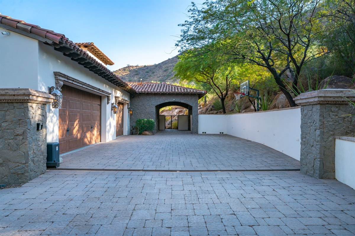 Gated Garage and Carport with Basketball Hoop