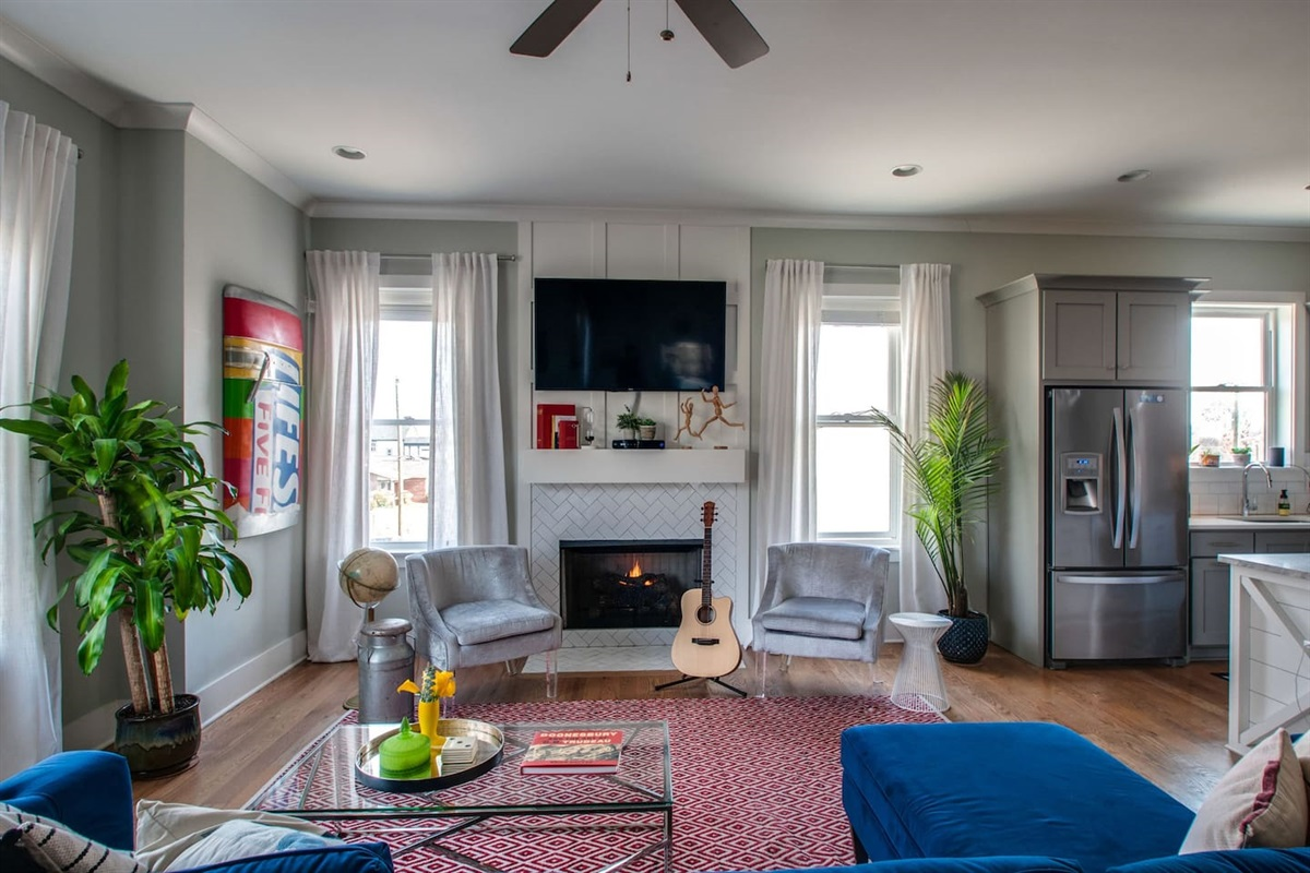 """Fireplace, 60""""TV and guitar for your entertainment"""