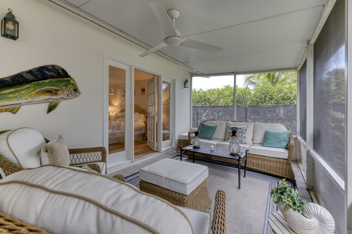 Enjoy Florida's stunning climate outdoors. Comfortable wicker furniture & outdoor dining bench. BBQ Grill and outdoor loungers.