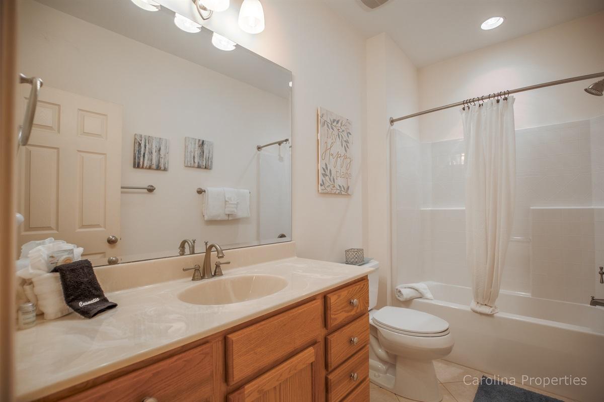 Main level full bath near bedrooms 2 and 3