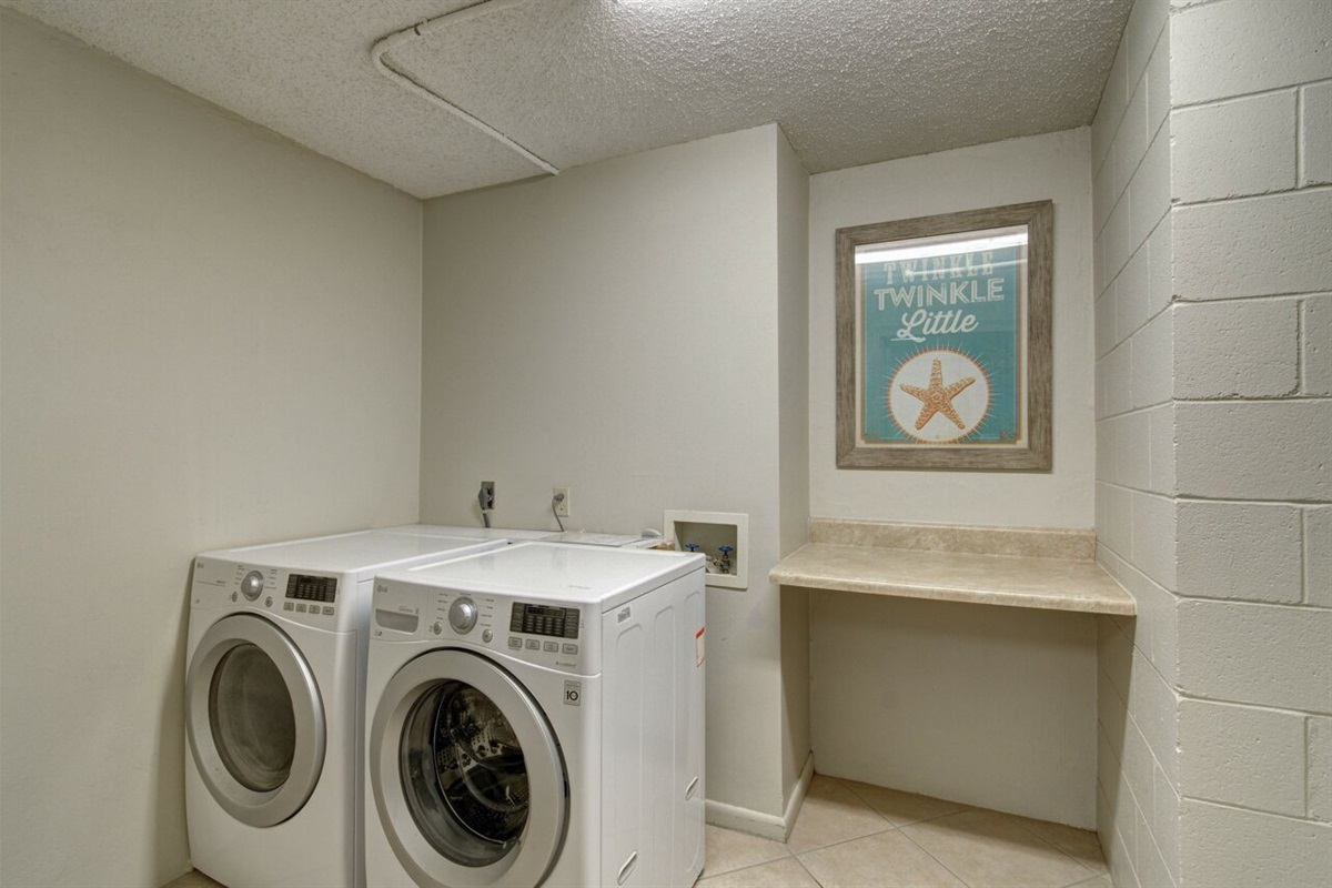 Washer and Dryer next to condo