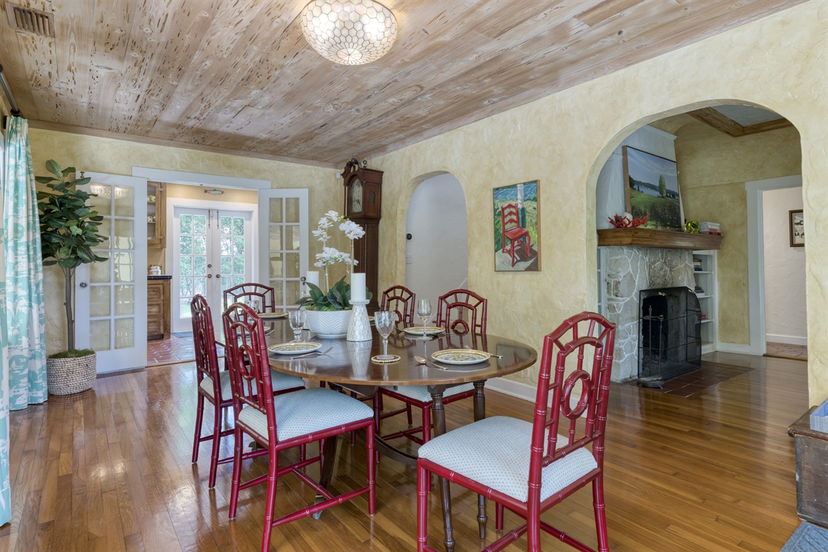 Welcome to the main house. Large Dining Room table for 6 under unique wood designed ceiling and stunning French doors.