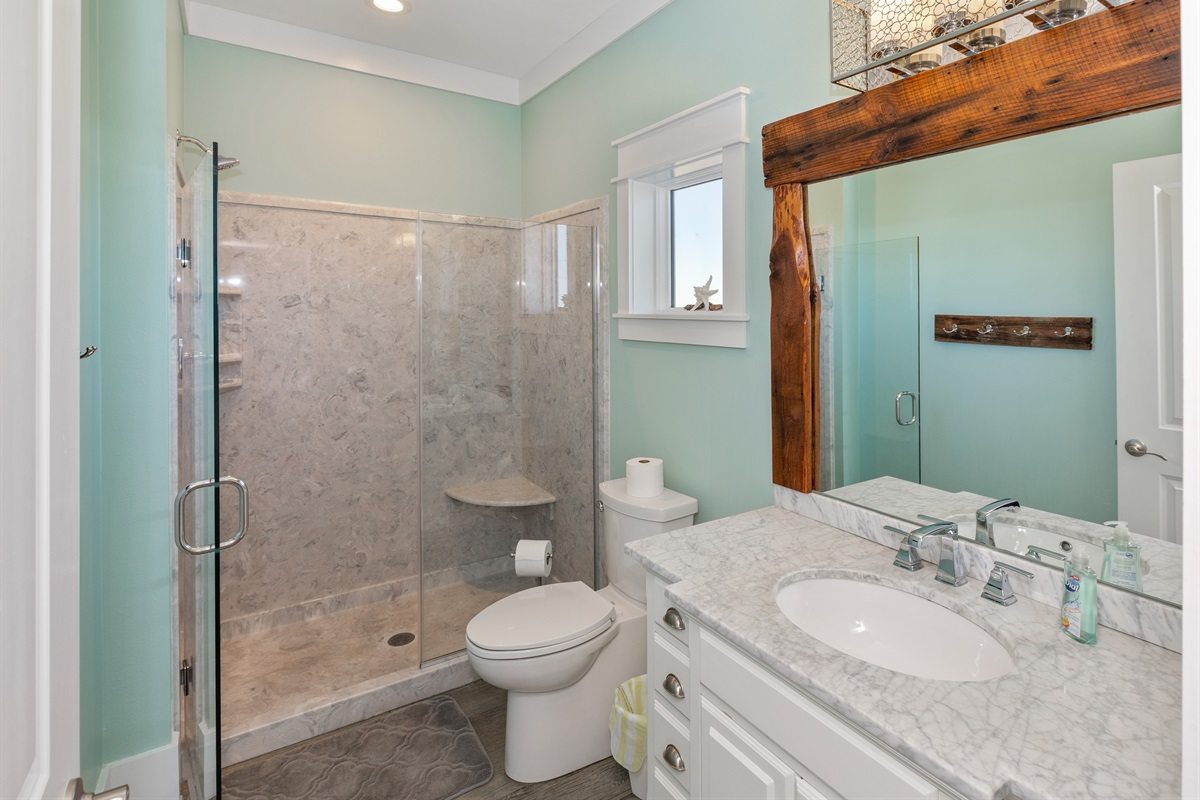 Third floor Queen suite with private bath boasts coastal chic decor.