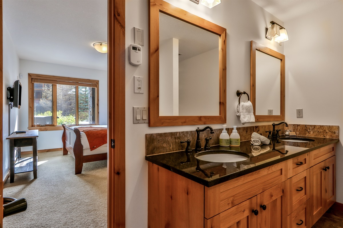 Double sinks and heated floors in the ensuite