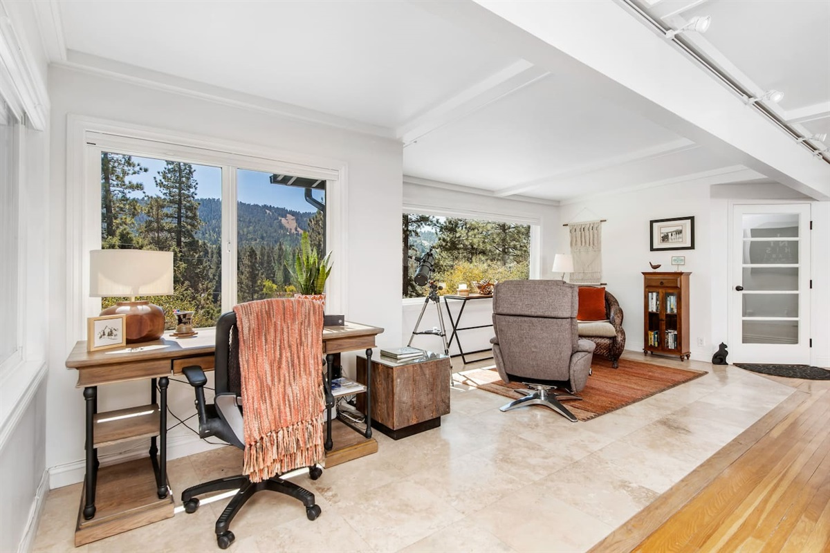"""Lounge (Lower Level): A lovely and rustic """"work from home"""" area with breathtaking views of Big Bear and high speed internet."""