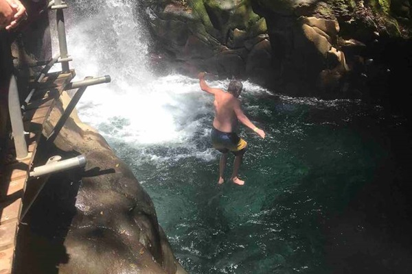 After a short easy trek we found this fabulous waterfall! Jumping is fun!