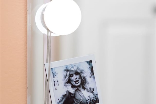 Complete with makeup lighting, a close-up mirror, plenty of electrical outlets, and of course...  Dolly decor!