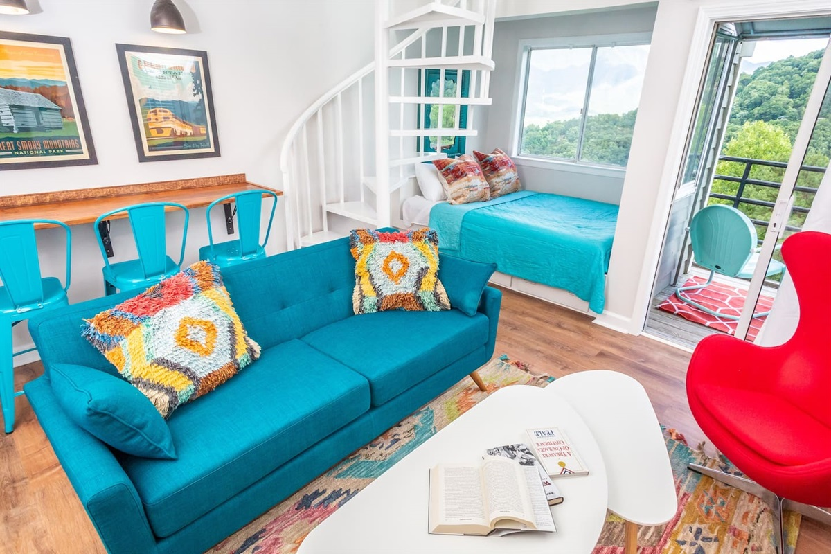 Vibrant colors for vacation mode! Built in queen next to the window