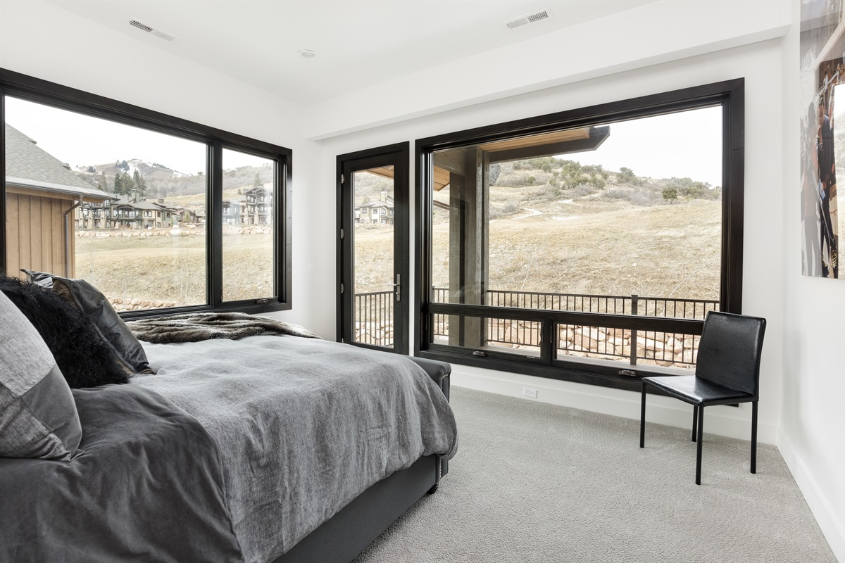 Bedroom 2: Kingsize bed, stunning views, door to deck.