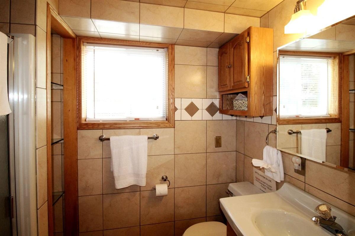 Full bathroom #2 with stall shower, modern, fully tiled