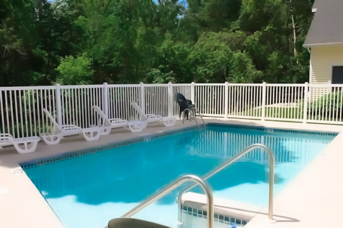 Outdoor swimming pool is perfect for your summer stays! The pool is fenced in and located in a private area next to shade trees.