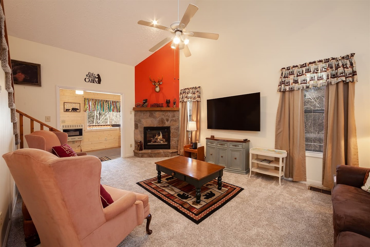 "Gather in the living room by the fireplace and watch a movie on the 65"" TV"