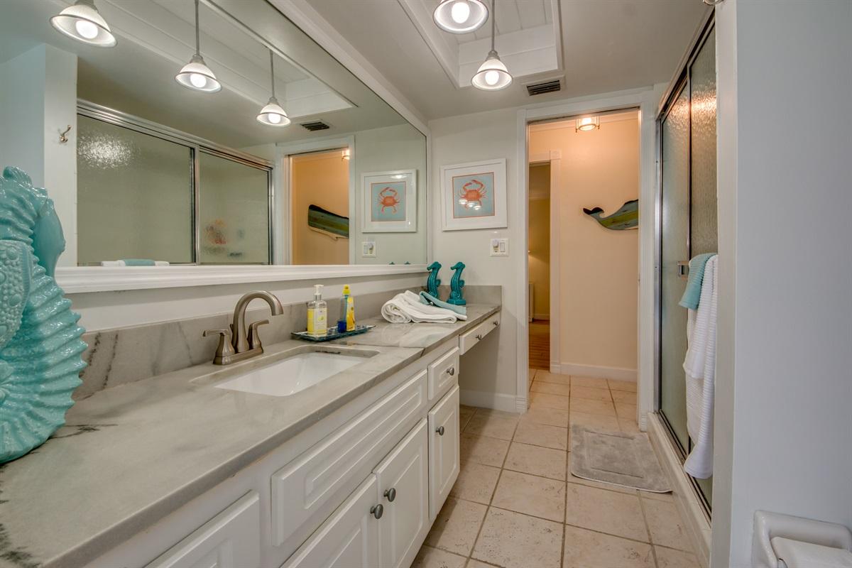 Pool Bath W/ Shower Looking Towards Bedrooms