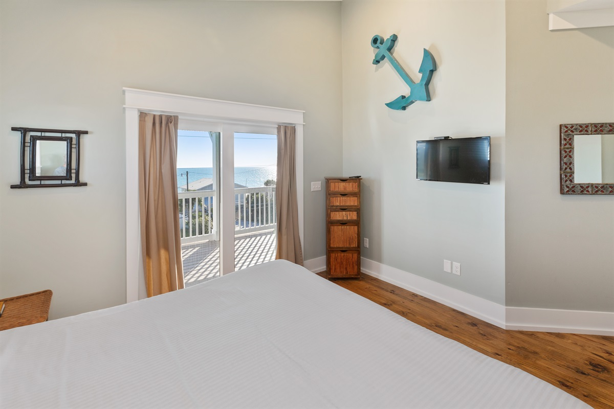 Third floor king suite with balcony overlooking Gulf.