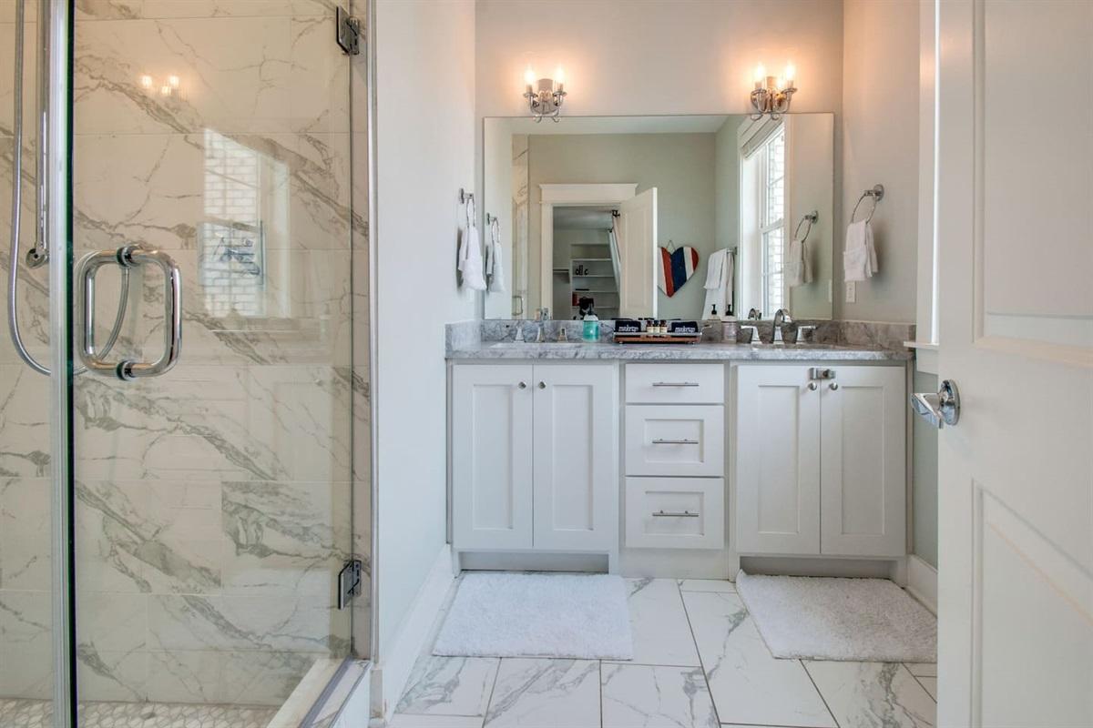 Premium towels and toiletries greet you in this spacious double-vanity, ensuite bathroom
