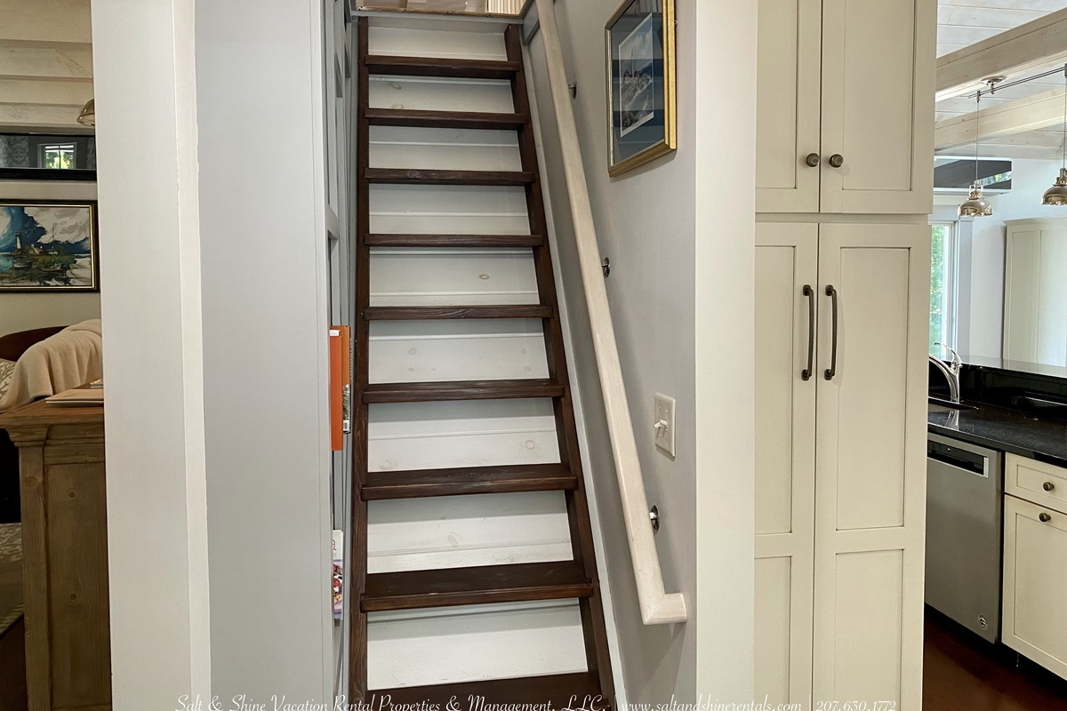 Steep stair case with handrail to sleeping loft
