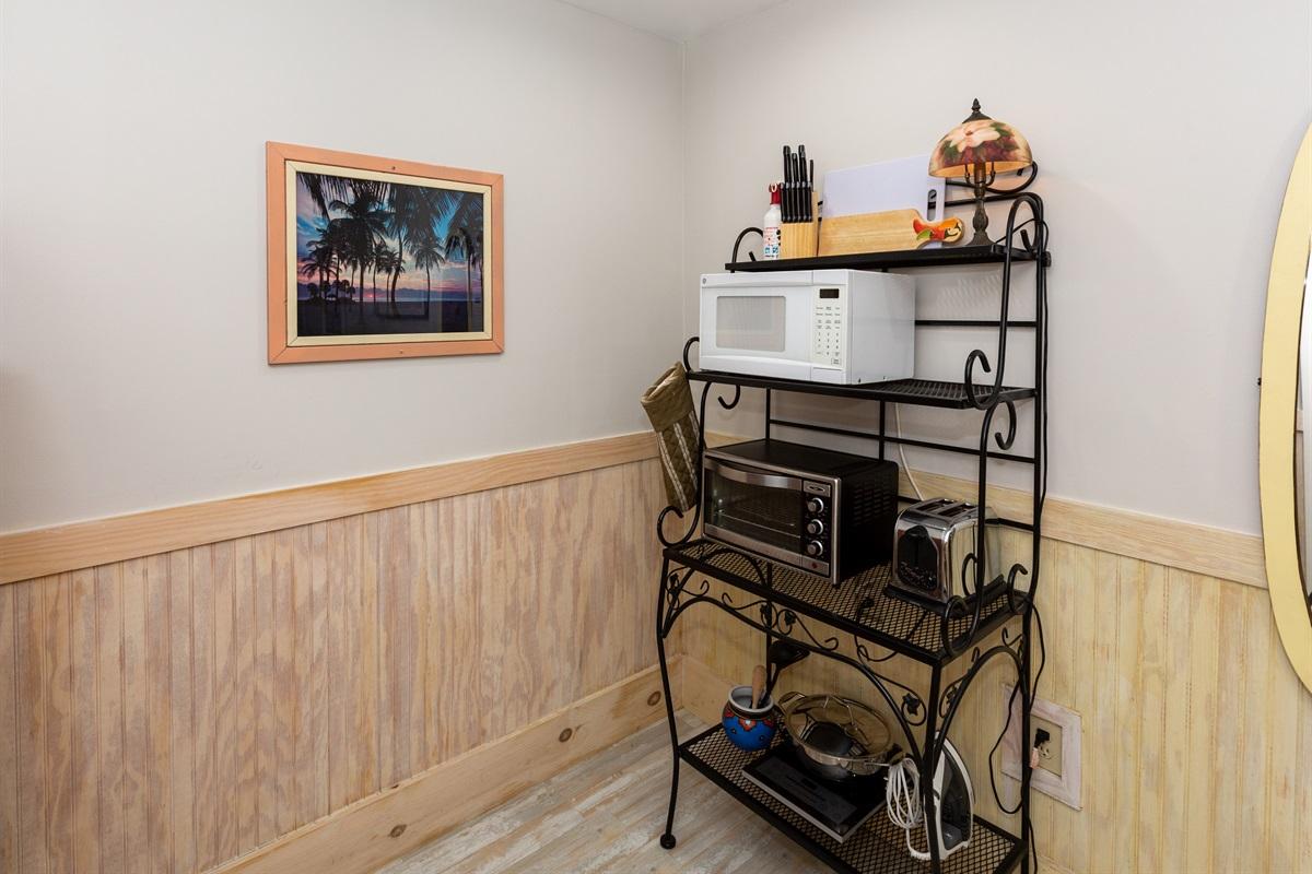 Studio kitchen ahs essentials seen here plus a portable cooktop.